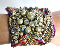 this etsy account has incredible handmade friendship bracelet cuffs...want one!