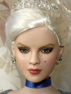 About Cinderella: Was created by Shannon Craven this doll repaint of DeeAnna Denton as Cinderella for the Summer 2011 issue of FDQ.  She was sold to a private collector.