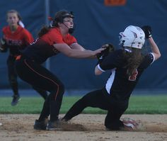 Ames shortstop Maddie Lynch tags out Newton's Audrey Lucas during a 9-8 win on Friday. Photo by Nirmalendu Majumdar/Ames Tribune  http://amestrib.com/sports/softball-late-rally-lifts-ames-past-newton