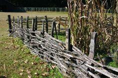 Love this colonial garden fence, woven, so pretty for a vegetable garden or pumpkin patch!