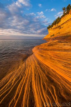 -    Sandstone striations on Lake Superior at sunset, Pictured Rocks National Lakeshore, USA. A kayak is the perfect way to explore Superior's stunning coastline.