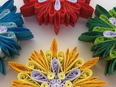 Snowflake Yellow Red Green Blue White, Christmas Tree Decoration, Winter Ornaments, Quilled Handmade Art, Paper Quilling, Dozen Set of 12 pcs. You can hang it on Christmas tree, use as fridge magnet, decorate Your bookshelf, dinner table or put it in lovely frame. Enough to decorate one small Christmas tree. This listing is for 12 pieces (3 yellow, 3 red, 3 green, 3 blue). Dimensions of one snowflake - 4 ″ x 4 ″ (10 cm x 10 cm). Made from 1/4 ″ (5 mm) paper strips of 90 g/m2 paper.