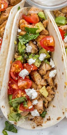 The BEST Chicken Tacos Recipe, ready in just 20 minutes! Juicy seasoned chicken topped with avocado, tomatoes, cilantro and cheese are a great idea for a quick and easy dinner (especially Taco Tuesday)!