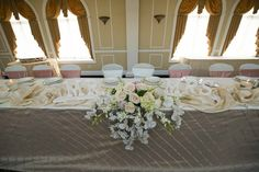 Mr. And Mrs. Sign with an elegant centerpiece with TC events LLC
