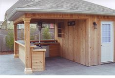 This guy is a master of his backyard domain. Not only does this shed have a bar, it has a refrigerator.   Photo Credit: www.Shedmaster.ca