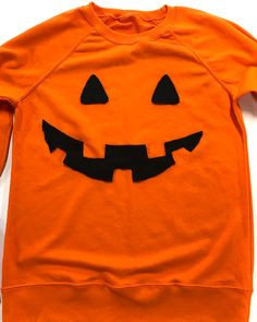 Learn how to make a no-sew pumpkin costume for Halloween with an orange  jumper 5c7599801