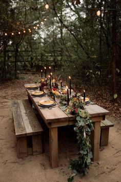 Rustic wooden table with moody floral design | Image by Century Tree Productions