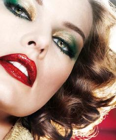 gold and green metallic eyeshadow and glossy ruby red lipstick