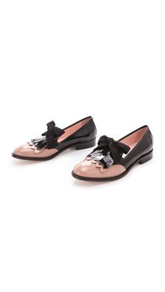 Dapper, yes indeed. But don't save them just for nights out on the town . . . they would be equally swell paired with a pair of skinnies. Women's Bow Tie Loafers by RED Valentino via Shopbop