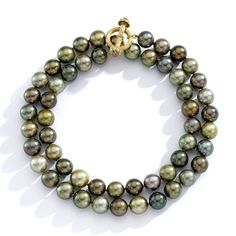 """Our amazing double strand of round, green-hued pearls. They say 'total power' while still having a lovely, sensitive and thoughtful quality.""- Mish Tworkowski, designer -Wmag"