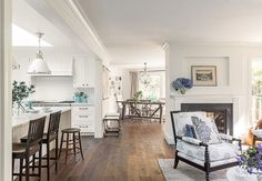The flooring is French Connection by Garrison in 'Caffe' Color. Rustic European White Oak 5/8″ x 7″ Planks.