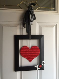 Valentine's door hanger..using a cheap frame, covered a cardboard heart with ribbon and painted the letters white and glued on.  Cheap and simple.