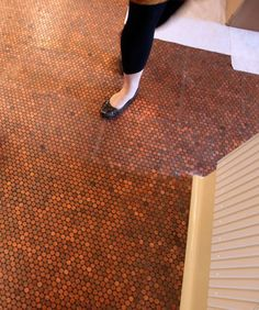i knew even before we bought our house that i wanted to put a penny tile floor in somewhere. as in real pennies. we had seen a floor like . Penny Tile Floors, Penny Backsplash, Big Design, House Design, Unique Flooring, Flooring Ideas, Restaurant New York, Grill Restaurant, Family Room Decorating