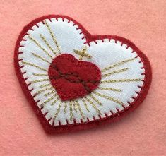 Sacred heart patch Hand Embroidered Patch Handmade Clothing Patch sew on, this little heart is a carefully hand embroidered sew on patch with a French know how. Details: ・Patch skillfully hand embroidered ・Made of cotton fabric on wool blend felt Hand Embroidery Patterns, Embroidery Stitches, Embroidery Designs, Handmade Clothes, Handmade Crafts, Faith Crafts, Catholic Crafts, Cloth Flowers, Clothing Patches