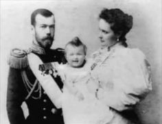 Tsar Nicholas, Empress Alexandra and smiling Grand Duchess Olga