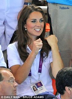 Impressed: The Duchess punched her fists in the air and clapped as she watched the swimmers
