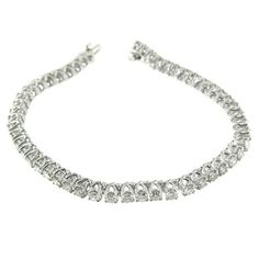 5.25 Ct White Gold Diamond Tennis Bracelet 14 Kt. 14 KT White gold diamond tennis bracelet. This beautiful bracelet contains round shape natural diamonds with a total weight of 5.25 Ct. The diamonds are rated I-G color and VS2-SI1 clarity. The bracelet measures 7.5 inches in length and 0.25 inches in width. The total weight of gold is 16.5 grams.
