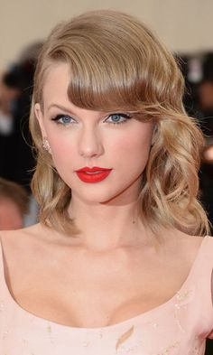 Taylor Swift looked stunning as she opted for a bright red statement lip, as…