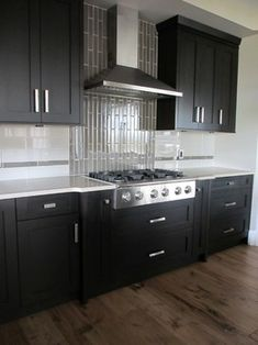Dark Kitchen Cabinets, Glass Backsplash Design Ideas, Pictures, Remodel, and Decor