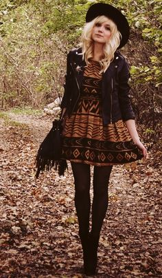 Leather jacket layered with cute little flare printed dress, leggings and booties. Finished with a hat and tassel purse.