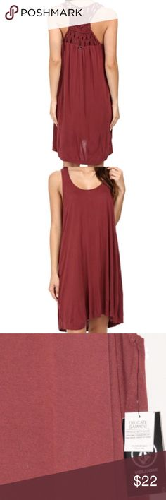 NWT Volcom Constellation Macrame Back Hi Lo Dress Tank dress in a loose, flowing A-line silhouette. Back panel in a knotted, macrame detail. Lightweight rayon in a draped jersey knit. Scoop neck. Racerback. Sleeveless. Slight high-low hem. Slip-on and unlined. Woven Stone locker tag at the left hem. Brand back set at the center back. 100% viscose. Machine wash and dry flat. Volcom Dresses High Low