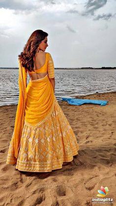 Actress Raashi Khanna Gorgeous Stills From Prathi Roju Pandaage Movie Shoot - Social News XYZ Half Saree Lehenga, Lehenga Saree Design, Lehnga Dress, Lehenga Style, Saree Look, Bridal Lehenga, Indian Gowns Dresses, Indian Fashion Dresses, Indian Designer Outfits