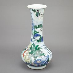Chinese Wucai Glazed Porcelain Vase  Late Ming Dynasty The body of compressed globular form rising to a tall neck and flared rim, set on a low ring foot, painted in the round with scholars and attendants in a garden setting below an image of two elephants and caretaker beside a poem on the neck. Height 16 inches.