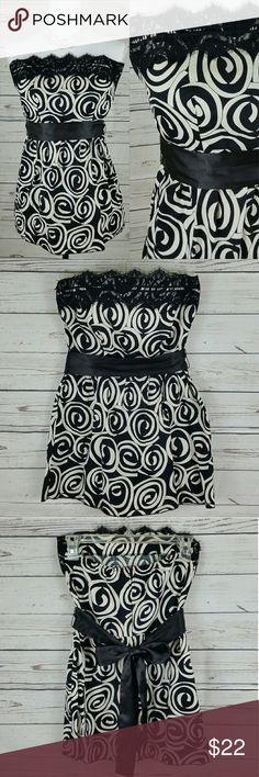 {Lipsy B&W Floral Strapless Top} Lipsy beautiful black and white floral strapless top. Features a lace trim neckline, silky waist tie, and a back zipper. Elastic around the back to help with it. Great condition.  Bust: 30 inches Waist: 26.5 inches Length: 23 inches  100% cotton Hand wash, hang or line dry Lipsy Tops