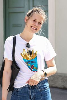 tifmys – Shirt: Ganni   Jeans: H&M   Bow Slippers: Miista   Bag: Céline Cabas Belt   Sunnies: Ray Ban Round Metal   Watch: Larsson & Jennings   Earrings: Asos