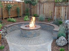 Fire Pit Design. retaining wall seating, maybe with a back for some decrotive pillows to add comfort.