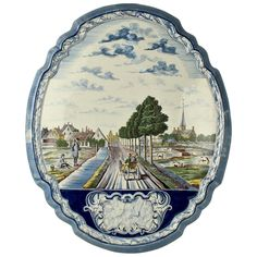Large Dutch Delft Polychrome Wall Plaque | From a unique collection of antique and modern delft and faience at https://www.1stdibs.com/furniture/dining-entertaining/delft-faience/