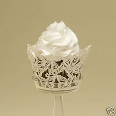 With our new Cupcake Wrappers in a delicate cut laser butterfly design, it is the perfect way to turn your cupcakes into a work of art. This designer laser-cut cupcake wrapper easily assembles to slip your favorite cupcake or candy-filled cup into f Wedding Cupcake Toppers, Wedding Cupcakes, Wedding Favors, Party Cupcakes, Wedding Cake, Butterfly Cupcakes, Butterfly Party, Wedding Store, Chic Wedding