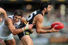 Matthew Pavlich of the Dockers tackles Domenic Cassisi of the Power during the round eight AFL match between the Port Adelaide Power and Fre...