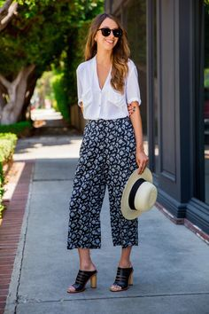 """Alyssa Sutter, Styling Associate - """"The key to wearing culottes is to find the right pair for you. Go for a slimmer cut or a pair in solid black if you're intimidated. I'm all about this trend, so I went for a printed pair and styled them with a white blouse and straw hat for a relaxed summer feel."""""""