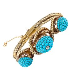 Antique Turquoise Yellow Gold Bracelet;   This Garrard & Co. bracelet features beautiful turquoise and one single diamond in the center. England  1870-1880.