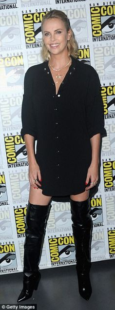 Atomic stunner: Charlize showcased her gorgeous gams in the leather boots...