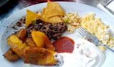 Platos Tipicos: This typical El Salvadorian breakfast made of standard national foods includes fried sweet plantains, casamiento (black beans and rice in an onion sauce) and salsa. Photo courtesy of Liz Henry via Flickr.com.