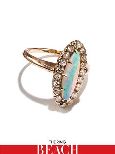 Doyle & Doyle Antique opal and European cut diamond ring, $1,800For information: doyledoyle.com