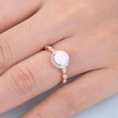 This is an opal engagement ring rose gold. The stones are Opal and VVS man made cz diamond. The center opal is about Round Cut. The stones can be replace with other gemstones.For example,if you dont like the CZ accent,you can ask me replace it with Rose Gold Engagement Ring, Engagement Ring Settings, Vintage Engagement Rings, Oval Engagement, Wedding Engagement, Gold Diamond Wedding Band, Diamond Bands, Opal Promise Ring, Diamond Cluster Ring
