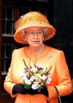 Queen Elizabeth......BET THE QUEEN HAS EYE GLASSES THAT MATCH THE COLOR OF HER HATS ALSO........SHE ALWAYS LOOKS SO NICE.....ccp