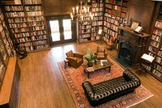 i would die for a library like that in my home someday. Reminds me of Ollivander's, but with books!