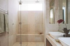 Shower design ideas | A double shower with built-in bench seat is a luxury worth affording.  - Mizu shower rose and arm from Reece.  - Classic travertine floor and wall tiles, 610mm x 610mm from Aeria Country Floors.