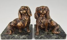 French Art Deco Bronze King Charles Spaniel Dog Bookends by Louis-Albert Carvin | See more antique and modern Home Accents at https://www.1stdibs.com/furniture/more-furniture-collectibles/home-accents