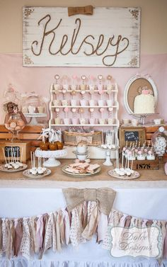 Vintage Cowgirl 5th Birthday Party - Love this dessert table, especially the birthday girl's name written in rope, the white shelf and the pink antique plates!