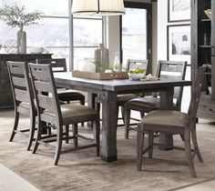 7-pc. Dining Room. Casual transitional dining is interpreted in handsome rectilinear shapes in this dining room set. A rustic Weathered Charcoal finish over pine solids is accented by Aged Iron Metal hardware and latte seat upholstery on the handsome slat back dining chair which offsets the modern version of a farm table with sturdy architecturally tapered block legs