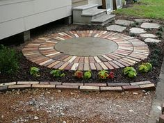 This is an old in-ground storage tank lid and vintage brick. A solution for the septic lid that shouldn't be covered!