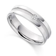 Awesome Flush set men us diamond wedding ring with round diamond within a satin finished channel detail