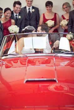 The wedding party ended photos at the ceremony and reception venue, Ravenswood Event Center. One area of the venue has an amazing collection of classic cars. Usually you cannot touch the cars, but an exception was made for the couple and they were able to pose in this fantastic red convertible...which happens to be the car from Ferris Bueller's Day Off!