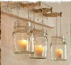 Hanging vases filled with votive candles or flowers.  Oh so cute!