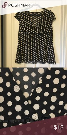 VON MOZART polka dot blouse VON MOZART brand blouse. It is black with white polka dots, capped sleeves, a v-neck and a robin with a bow with an empire waist look.  I cut the tag off but I believe it to be a 16. VON MOZART Tops Blouses